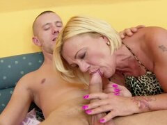 Blonde granny Orhidea sucks a dick and welcomes it in her hairy vag