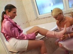Maid and mistress take clothed bath