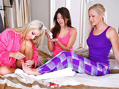Three stunning college teens have a sleep over and try some lesbian stuff