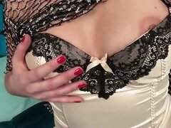Sensual blonde milf teases as she slowly pulls down her sexy lingerie to give her tits some pleasure before rubbing her needy pussy...
