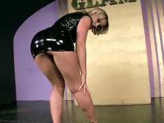 Blonde Kathia Nobili dressed in tight latex