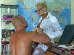 Sexy blonde secretary in stockings gets her pussy licked good