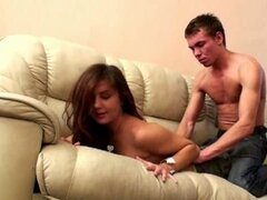 Long haired beauty gets nailed on the couch