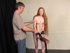 Innocent teen redhead bound by her master