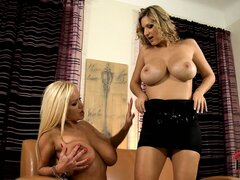 Blondes Sharon and Carol show off big boobs and suck on the nipples