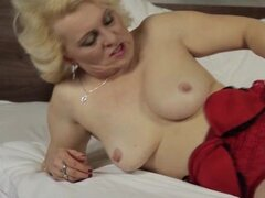 Horny blond mature housewife spreading her legs and stretches her wet pussy