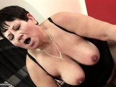 Lawanda gets her drooping titties fucked and covered with sperm