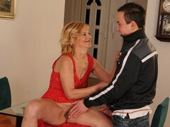 A sexy older mom in red lingerie has a fresh faced bloke to bang her beaver