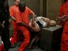 Sensual blonde with black stockings caught in prison gang bang
