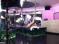 Blue Angel has been to a pole dancing class. While she is still a bit shy to do it in public, she likes to practice in her living room. Watch her twirl down a pole in her red platform heels and sexy leotard. She turns herself on so much with her acrobatic