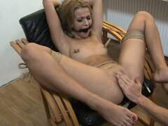 Petite blonde has her nipples abused and is teased with a pinwheel