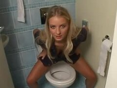 Beautiful Girl Taking A Piss In The Toilet.