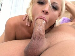 She slobbers on his cock so it slides down her throat easier
