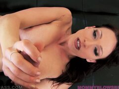 She lies back rubbing her cunt and holding onto a cock before sucking