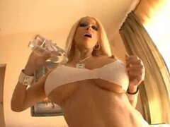 Gina Lynn pours oil all over her sexy titties