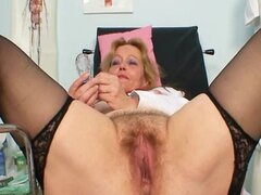 Filthy toys her hairy pussy with speculum