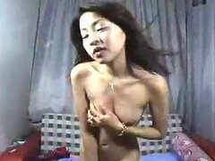 Asian Babe Strips and Dances in a Sexy Video