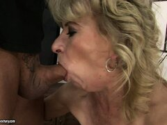 Blonde grandma blows his boner...