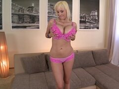 Spicy blonde MILF pornstar Sandra Star demonstrated her fake tits
