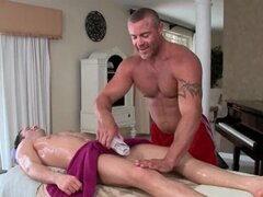 Excited gay masseur licking male ass and oiling body
