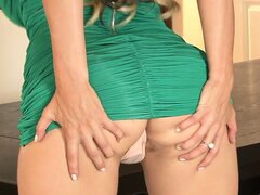 Posing and teasing in her sexy green dress, this MILF ends up so wet