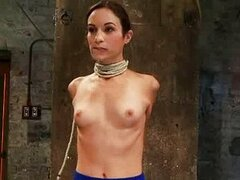 Brunette with bound neck and elbows