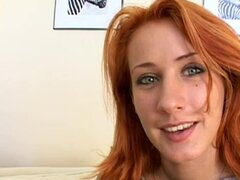 Frisky redhead demonstrates feet in stockings