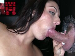 Gloryhole loving babe pleases two cocks