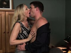 Blonde MILF babe Julia Ann sucking a big hard cock in her office