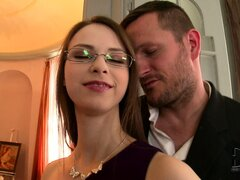 Brunette with glasses uses her supple body to please a huge dick
