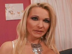Naughty blonde MILF gets hammered in all her holes with ebony and ivory cocks