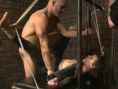 BDSM Fuck for a Hot Brunette Tied to a Traversal Pole