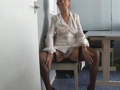 Attractive Granny in short skirt strips