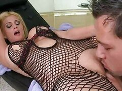 Pale busty blonde in black fishnet bodystocking gets her nookie licked