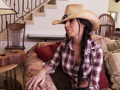 Sexy cowgirl with long black hair and gorgeous tits decides to ride a young cowboy