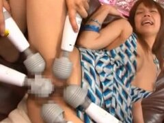 Akina has several vibrators all tickling her clit and twat