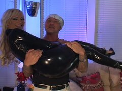Yummy blonde slut in latex milking two huge boners