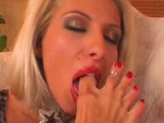 Sexy blonde Clara G. licks her feet and fingers her nice pussy