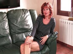 Redheaded mom plays with her nipples