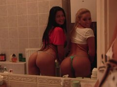 Juicy babes are having fun at home, comparing each other's asses