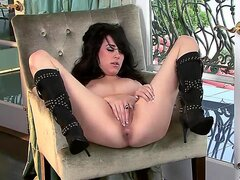 Attractive turned on young looking brunette Heather Joy with long hair and hot sexy body in provocative boots spreads her legs and fingers her sweet wet honey pot to orgasm