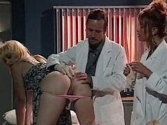 Classic threesome sex on doctor's cabinet