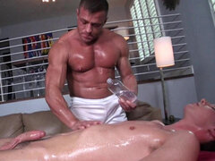 Man with muscles gives gay massage