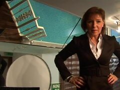 Redhead milf in business outfit strokes dick