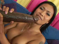 Asian hottie enjoys monster cock