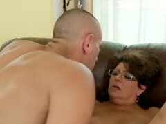 Mature and a but chubby honey Gigi M enjoys in getting a full service: getting her hairy pussy licked and then teased with some sex toys and in the end even rammed hard for the cam
