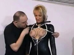 Perky Female In Latex Apparatus BDSM