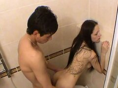Brunette teen sucks his cock and gets fucked in shower