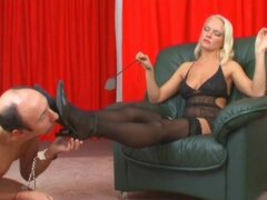 Mistress in stockings pisses on his face