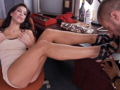 Superb brunette teases with her feet